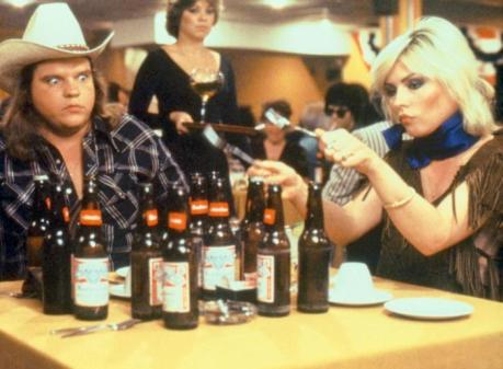 Debbie Harry plays the fork 'n empties for an astonished Meat Loaf.