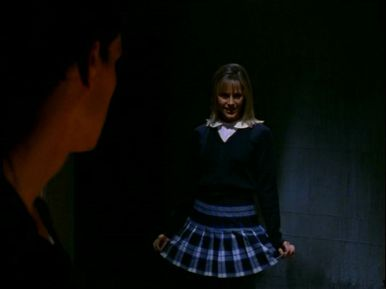 Darla teases Angel in her Catholic schoolgirl uniform. It's doubly perverse because the guise actually suits her!