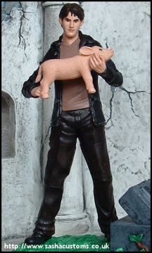 Sculptress Sacha has created a figurine of Xander holding the ill-fated Razorbacks mascot.