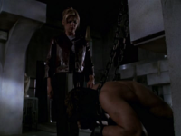 Buffy with Angel in chains