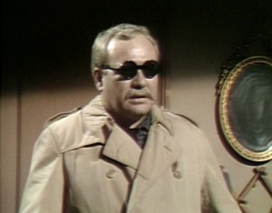 Sam's new look for blindness, which also doubles for dirty old man incognito attempting to enter an adult book store private booth. He's even got the trenchcoat!