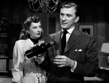 Handsome Kirk Douglas and his unimpeachable chin cleft. He's a pitiful drunk, a pathetic hanger-on, a strangely passive extortionist, and a masochistic extortion victim.